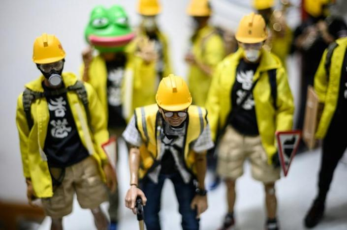 The models boast many features of the street protests (AFP Photo/Philip FONG)