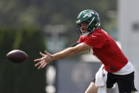 New York Jets quarterback James Morgan tosses the ball during NFL football practice Wednesday, July 28, 2021, in Florham Park, N.J. (AP Photo/Adam Hunger)