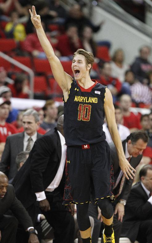 Maryland's Jake Layman (10) celebrates making a three-pointer to end the first half of N.C. State's game against Maryland at PNC Arena in Raleigh, N.C. Monday, Jan. 20, 2014. (AP Photo/The News & Observer, Ethan Hyman)