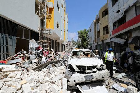 A member of the Somali security forces walks through the scene of an explosion in Mogadishu, Somalia Fabruary 4, 2019. REUTERS/Feisal Omar