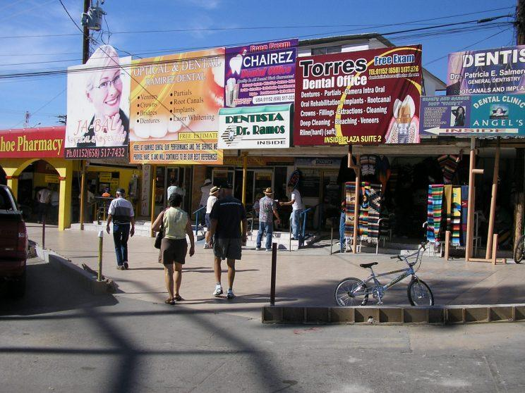 Less than a block after crossing into Mexico, U.S. tourists are bombarded with billboards touting the dental services in Los Algodones. (Photo: Oscar Avila/Chicago Tribune/MCT via Getty Images)