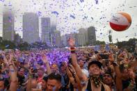 Confetti flies as people gather at Chicago's Grant Park during the Pride in the Park festival, Saturday, June 26, 2021. (AP Photo/Shafkat Anowar)
