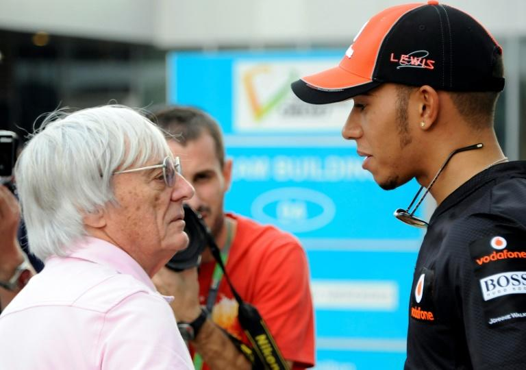 Controversial remarks: Bernie Ecclestone with Lewis Hamilton