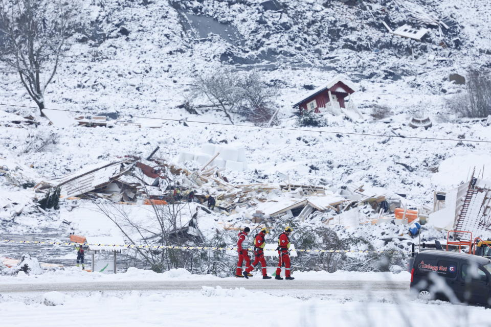 Rescue crews work in the area at Ask in Gjerdrum, Saturday Jan. 2, 2021, after a massive landslide smashed into a residential area near the Norwegian capital on Wednesday. The landslide cut across a road through Ask, leaving a deep ravine that cars could not pass. (Tor Erik Schroeder/NTB via AP)
