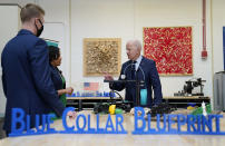 President Joe Biden speaks during a tour of the Cuyahoga Community College Manufacturing Technology Center, Thursday, May 27, 2021, in Cleveland. (AP Photo/Evan Vucci)