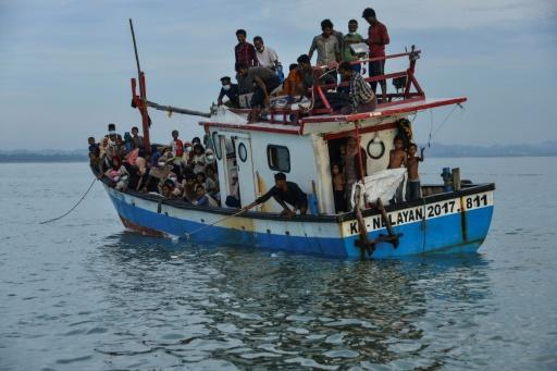 Nearly 100 Rohingya were reportedly plucked from a rickety vessel onto an Indonesian fishing boat