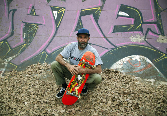 Skateboarder Dallas Oberholzer, 46, poses for a photo at the Germiston Lake Skateboard Park, near Johannesburg, Saturday, July 3, 2021. The age-range of competitors in skateboarding's Olympic debut at the Tokyo Games is remarkably broad and 46-year-old Dallas Oberholzer will go wheel-to-wheel with skaters less than half his age. (AP Photo/Denis Farrell)