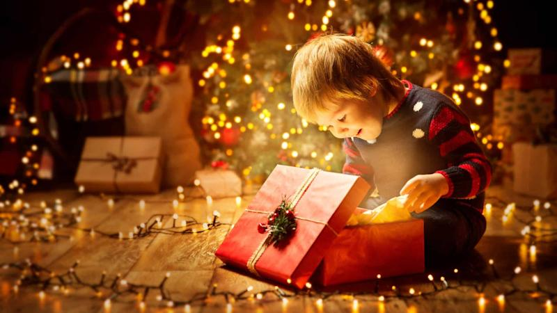 young child opening christmas present