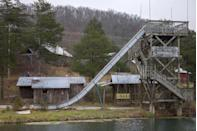"""<p><strong>Dogpatch USA - Marble Falls, AR</strong></p><p>Many believed the hillbilly-themed amusement park in the Ozark region was set to be a success when it opened its doors in 1968. However, low attendance rates forced the park to shutter its gates in 1993. Today, much of the original park still stands as an eerie remembrance. </p><p>Photo: Wikimedia Commons/<a href=""""https://en.wikipedia.org/wiki/Dogpatch_USA#/media/File:Abandoned_water_slide_in_Arkansas_(2014).jpg"""" rel=""""nofollow noopener"""" target=""""_blank"""" data-ylk=""""slk:kenzie campbell"""" class=""""link rapid-noclick-resp"""">kenzie campbell</a><br></p>"""
