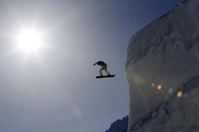 Shaun White of the United States takes a jump during a Snowboard Slopestyle training session at the Rosa Khutor Extreme Park, prior to the 2014 Winter Olympics, Tuesday, Feb. 4, 2014, in Krasnaya Polyana, Russia. (AP Photo/Andy Wong)