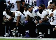 Baltimore Ravens players kneel for the American National anthem during the NFL International Series match between Baltimore Ravens and Jacksonville Jaguars at Wembley Stadium on September 24, 2017 in London, England. (Photo by Alex Pantling/Getty Images)