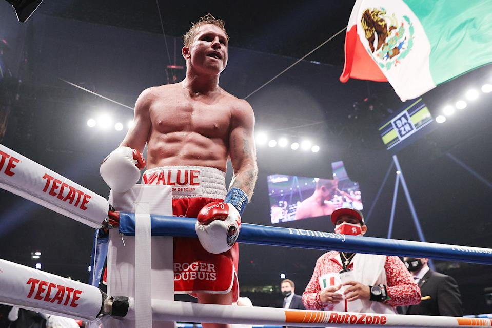 SAN ANTONIO, TEXAS - DECEMBER 19: In this handout image provided by Matchroom, Canelo Alvarez celebrates after defeating Callum Smith (not pictured) during their super middleweight title bout at the Alamodome on December 19, 2020 in San Antonio, Texas. (Photo by Ed Mulholland/Matchroom via Getty Images)