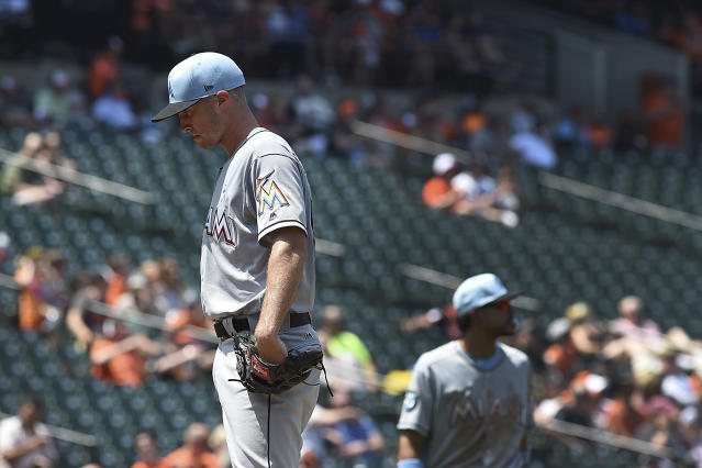 Miami Marlins pitcher Trevor Richards pauses before leaving a baseball game against the Baltimore Orioles' in the fourth inning Sunday, June 17, 2018, in Baltimore. (AP Photo/Gail Burton)