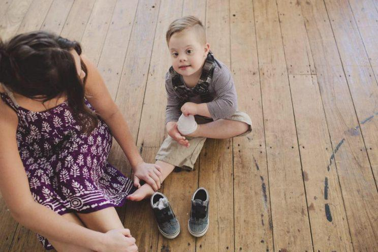 Parker Myles is a child with Down syndrome that often doesn't enjoy getting haircuts. (Photo: Kat Abianac)