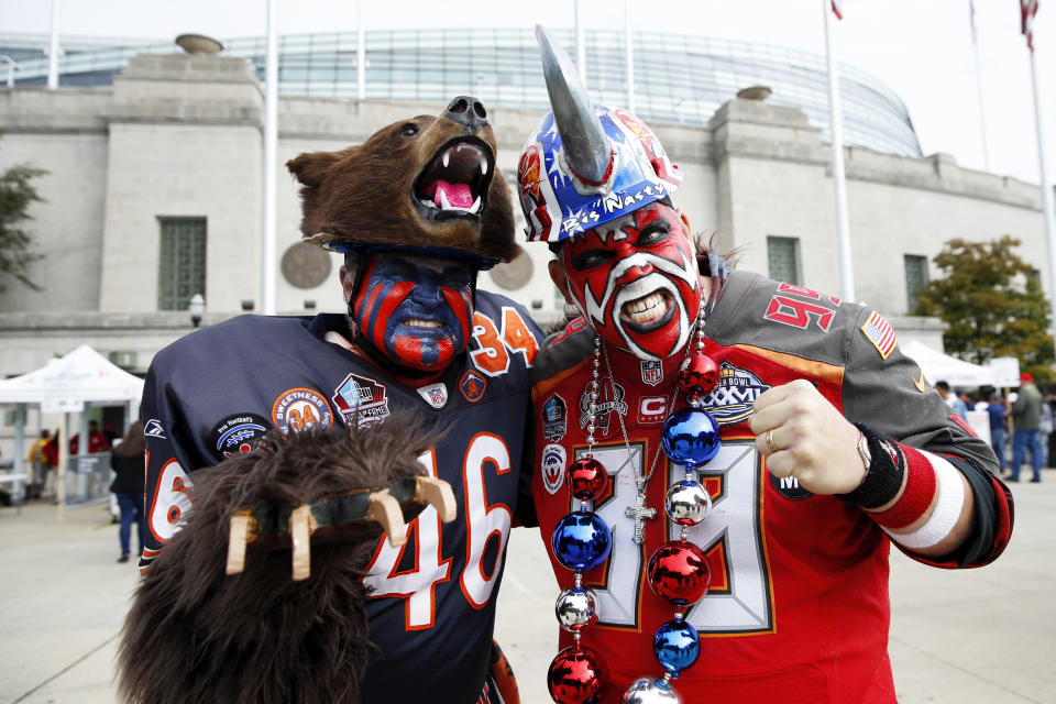 "Tampa Bay Buccaneers fan Keith ""Big Nasty"" Kunzig meets with Chicago Bears superfan Don ""Bearman"" Wachter. (Photo by Joe Robbins/Getty Images)"