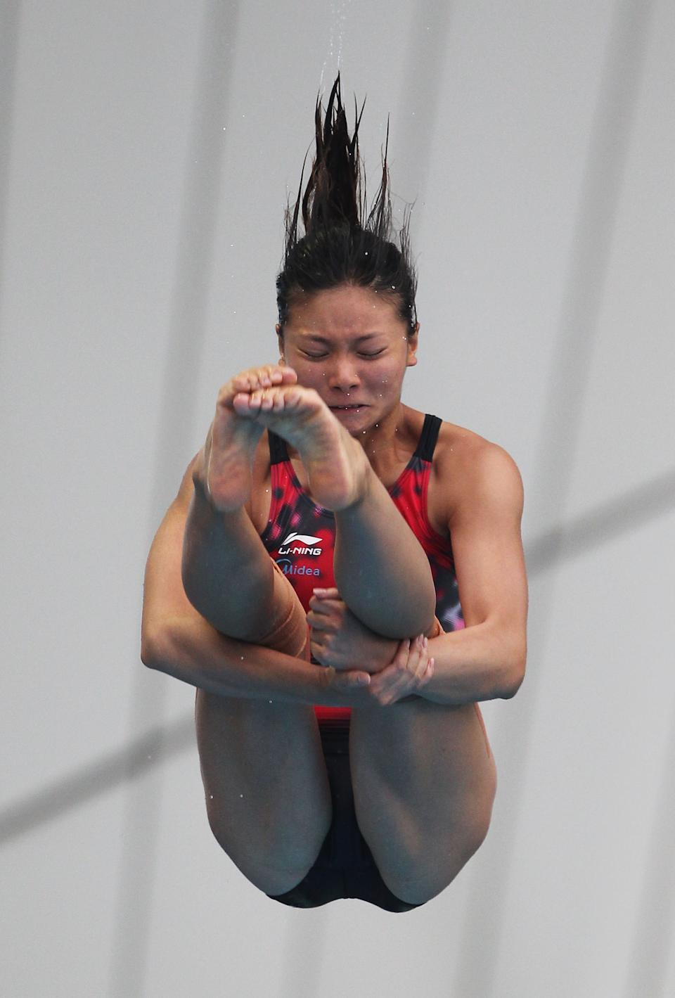SHANGHAI, CHINA - JULY 23: Zi He of China competes in the Women's 3m Springboard Final during Day Eight of the 14th FINA World Championships at the Oriental Sports Center on July 23, 2011 in Shanghai, China. (Photo by Clive Rose/Getty Images)