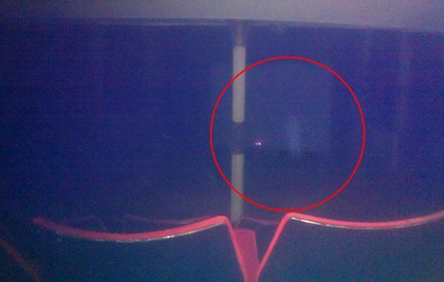 Daniel says the misty figure could only be seen on the photo. Photo: Caters News