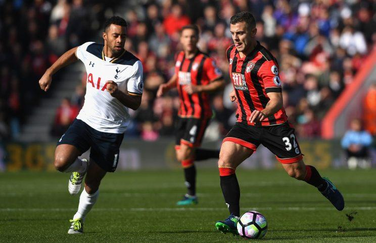 Dembele and Wilshere of Bournemouth compete in midfield