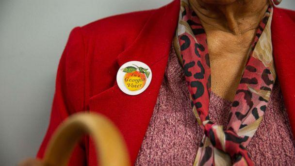 PHOTO: A voter wears a sticker that reads 'I'm a Georgia Voter' at a polling station in Atlanta, Ga., Nov. 6, 2018. (Kevin D. Liles/Bloomberg via Getty Images)