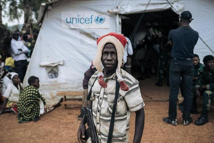 'Not choirboys': A militiaman stands guard during talks with ex-warlords in the village of Wadda