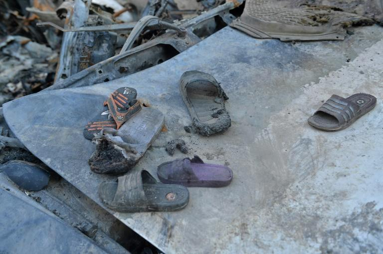 Burnt shoes are pictured amid the debris of Ezmarai Ahmadi's house, damaged in the US drone strike (AFP/Hoshang Hashimi)