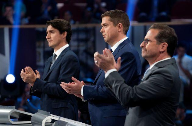Liberal Leader Justin Trudeau, Conservative Leader Andrew Scheer and Bloc Québécois Leader Yves-Francois Blanchet applaud as they take part in the federal leaders' French-language debate in Gatineau, Que. on Oct. 10, 2019.