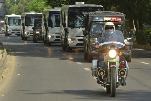 Police escort buses carrying Pakistan's squad en route to Lahore airport Sunday to board a flight for their tour of England