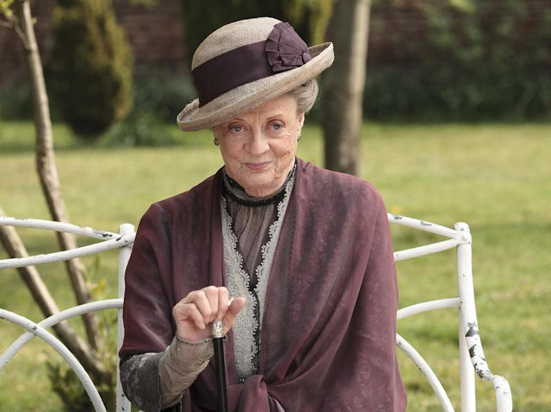 "In this image released by PBS, Maggie Smith as the Dowager Countess Grantham, is shown in a scene from the second season on ""Downton Abbey.""  The 78-year-old actress, who portrays Lady Grantham in the popular PBS series, told ""60 Minutes"" that she hasn't watched the drama because doing so would only make her agonize over her performance. She said she may watch it someday. (AP Photo/PBS, Carnival Film & Television Limited 2011 for MASTERPIECE, Nick Briggs)"