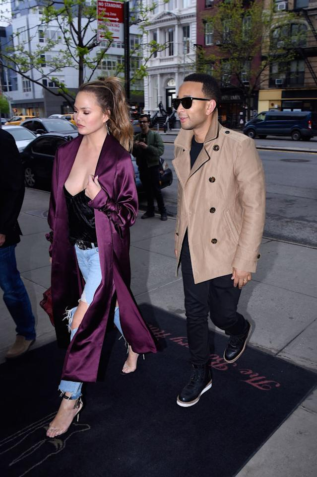 <p>Chrissy Teigen is the latest celeb to make loungewear a day-time dependable. The 31-year-old model sashayed through Manhattan in a burgundy silk robe teamed with on-trend busted knee jeans and a ribbed black tank-top. <i>(Photo: Getty)</i> </p>