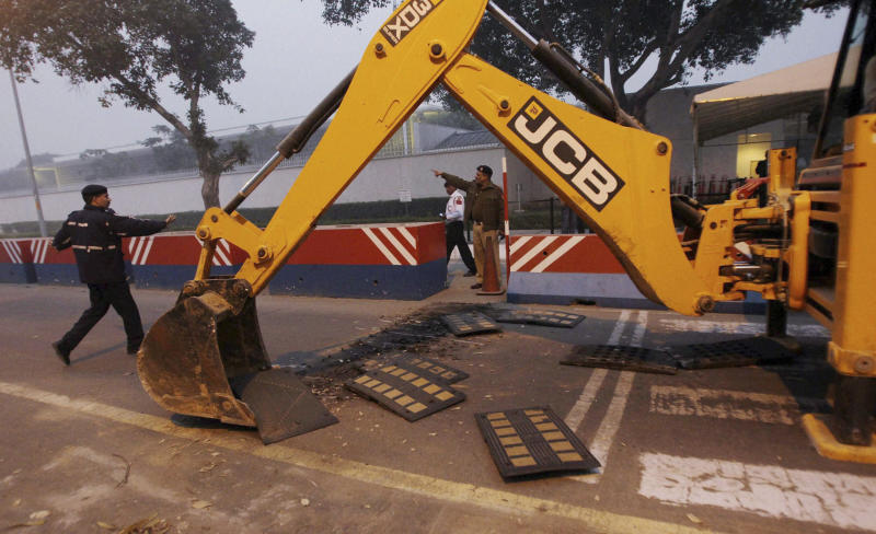 "Indian police remove barricades that had been erected as a safety measure outside the main entrance of U.S Embassy, reportedly in retaliation to the alleged mistreatment of New York based Indian diplomat Devyani Khobragade, in New Delhi, India, Tuesday, Dec. 17, 2013. The arrest and strip search of the Indian diplomat escalated into a major diplomatic furor Tuesday as India's national security adviser called the woman's treatment ""despicable and barbaric."" (AP Photo) INDIA OUT"