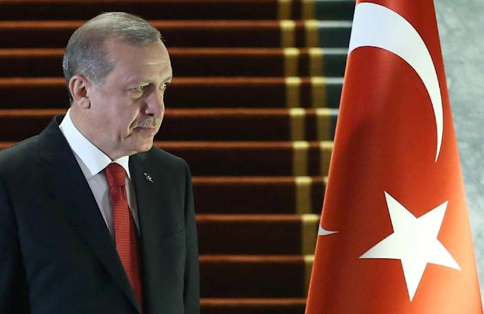 """""""I strongly condemn the terror attack which was carried out by a suicide bomber of Syrian origin,"""" Erdogan said in a speech in Ankara in his first reaction to Tuesday's blast in Istanbul (AFP Photo/Adem Altan)"""