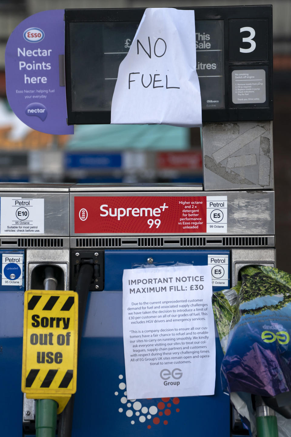 Closed pumps are seen on the forecourt of a petrol station in Manchester which has run out of fuel after an outbreak of panic buying in the UK, Monday, Sept. 27, 2021. British Prime Minister Boris Johnson is said to be considering whether to call in the army to deliver fuel to petrol stations as pumps ran dry after days of panic buying. ( AP Photo/Jon Super)