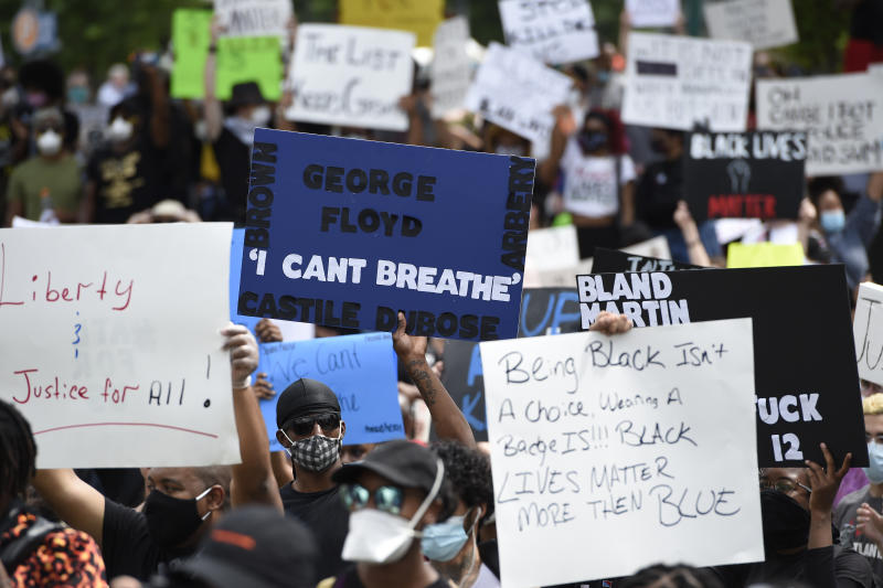 Demonstrators protest in Centennial Olympic Park, Friday, May 29, 2020 in Atlanta. Protests were organized in cities around the United States following the death of George Floyd during an arrest in Minneapolis. (AP Photo/Mike Stewart)
