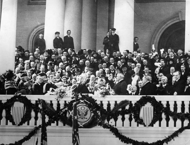 Warren G. Harding, center right, takes the oath of office administered by Chief Justice Edward D. White on the East Portico of the Capitol building in Washington, D.C., March 4, 1921. Harding is sworn in as the 29th president of the United States. (AP Photo)