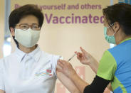 Hong Kong Chief Executive Carrie Lam, left, receives COVID-19 vaccinations at a Community Vaccination Centre in Hong Kong Monday, Feb. 22, 2021. (AP Photo/Vincent Yu)