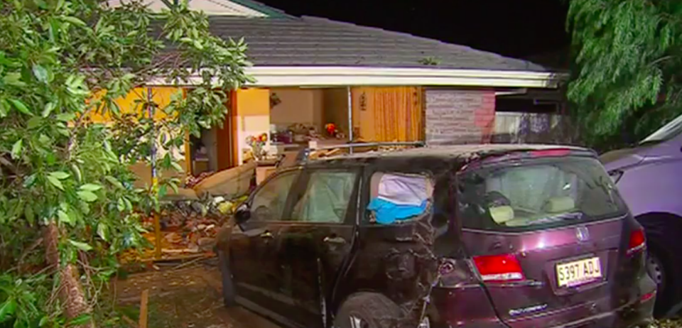 A car crashed into the living room of a house in Adelaide overnight. Source: 7 News