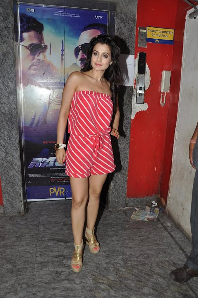 Keeping is super cheery is Amisha Patel in this pink and white striped playsuit. But why the glum face girl?