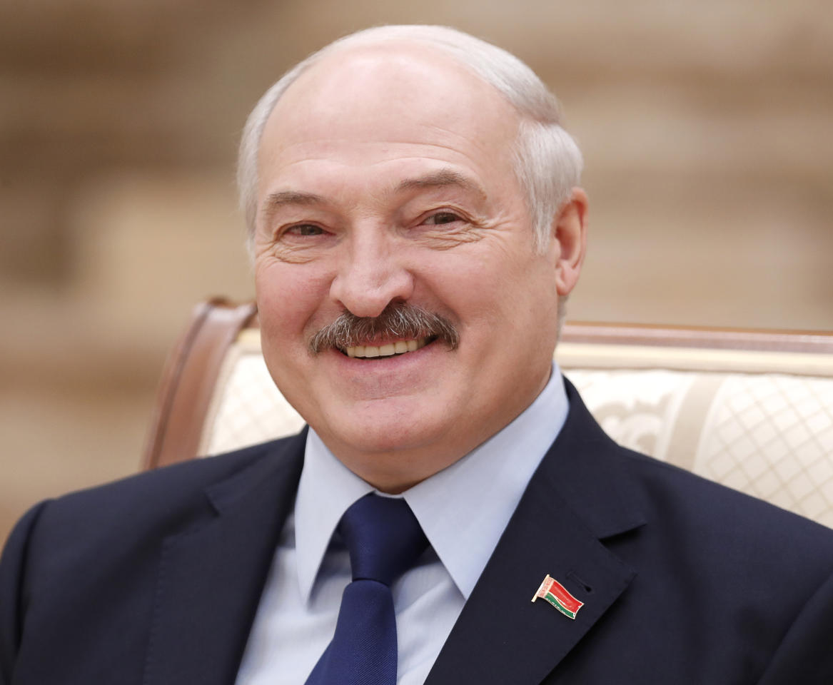 Belarusian President Alexander Lukashenko smiles during a news conference in Minsk, Belarus, Friday, Dec. 14, 2018. (Vasily Fedosenko/Pool Photo via AP)