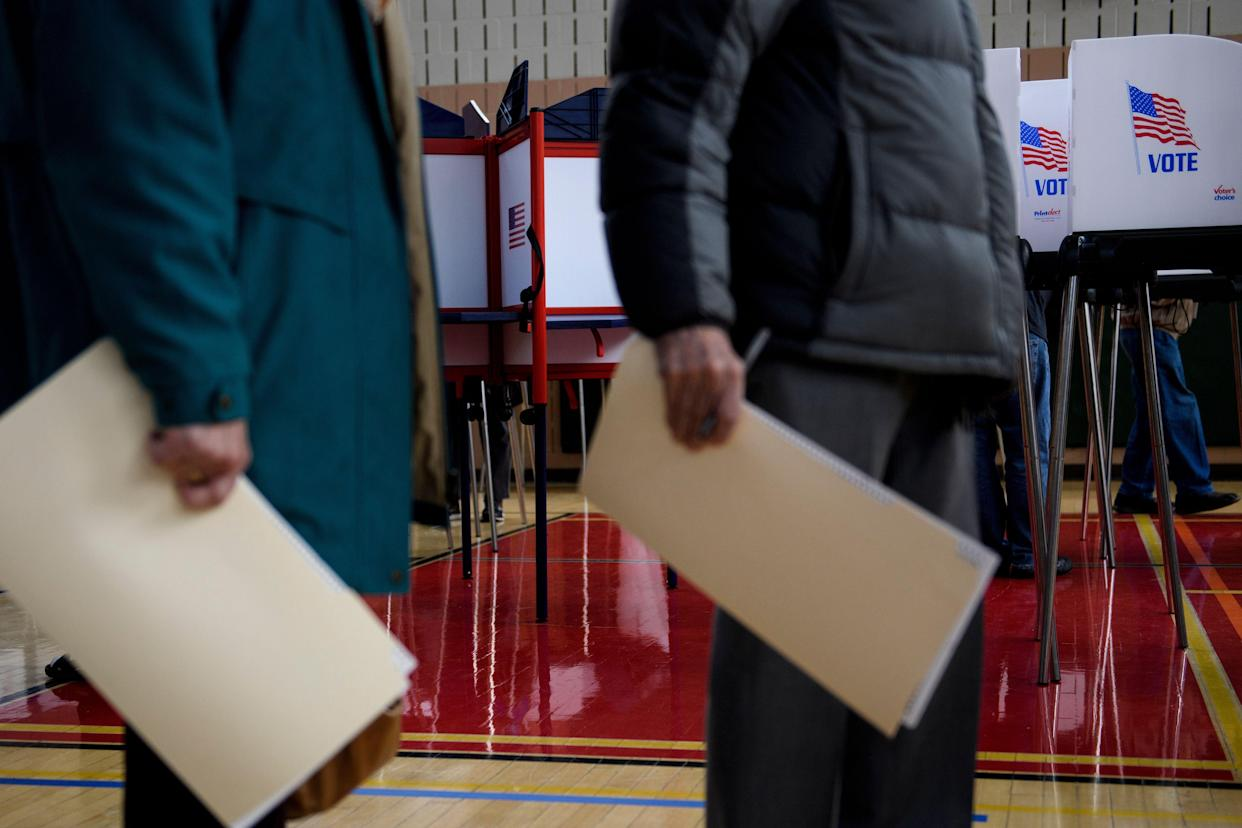 "<span class=""s1"">Early voters in Potomac, Md., on Oct. 25. (Photo: Brendan Smialowski/ AFP/Getty Images)</span>"