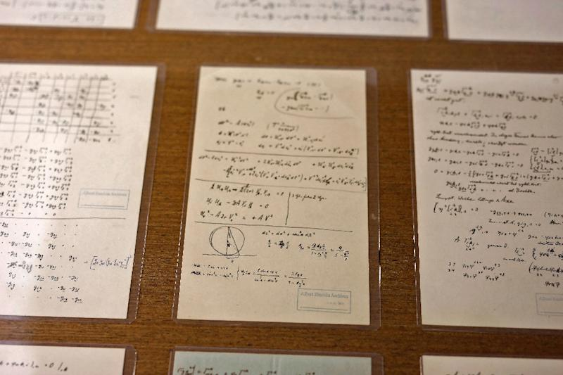 Some of Albert Einstein's manuscript pages on display at the Hebrew University of Jerusalem, in an exhibition to mark 140 years since his birth (AFP Photo/MENAHEM KAHANA)