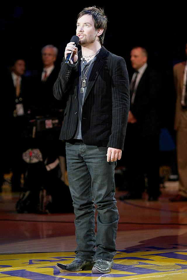 """Before tip off, """"American Idol"""" winner David Cook serenades the sell-out crowd with a rousing rendition of the national anthem. Noel Vasquez/<a href=""""http://www.gettyimages.com/"""" target=""""new"""">GettyImages.com</a> - June 10, 2008"""