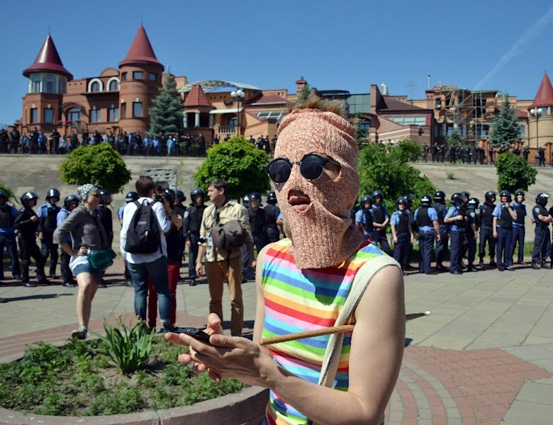 A masked gay activist pictured in June 6, 2015, when the first Gay Pride march in Kiev took place since fighting with pro-Moscow rebels broke out (AFP Photo/Genya Savilov)