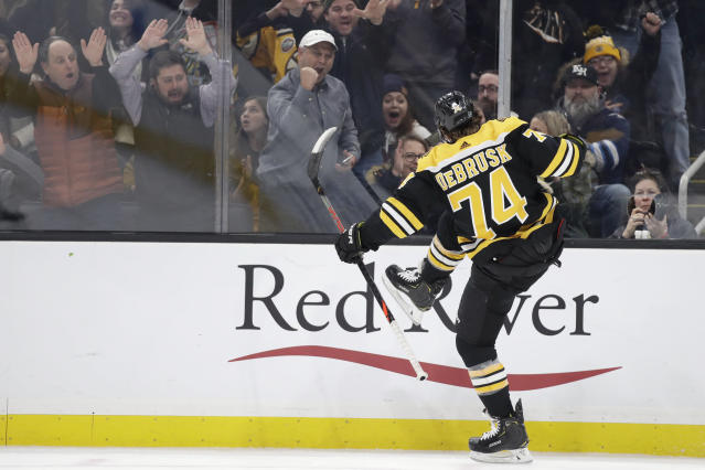 Boston Bruins left wing Jake DeBrusk (74) celebrates his goal against the Winnipeg Jets during the second period of an NHL hockey game Thursday, Jan. 9, 2020, in Boston. The Bruins won 5-4. (AP Photo/Elise Amendola)