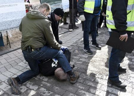 A man is detained after trying to hit Finnish Foreign Minister Timo Soini at the Korson Maalaismarkkinat country fair in Vantaa, Finland March 24, 2019.  Lehtikuva/Heikki Saukkomaa via REUTERS  ATTENTION EDITORS - THIS IMAGE WAS PROVIDED BY A THIRD PARTY. NO THIRD PARTY SALES. NOT FOR USE BY REUTERS THIRD PARTY DISTRIBUTORS. FINLAND OUT. NO COMMERCIAL OR EDITORIAL SALES IN FINLAND.