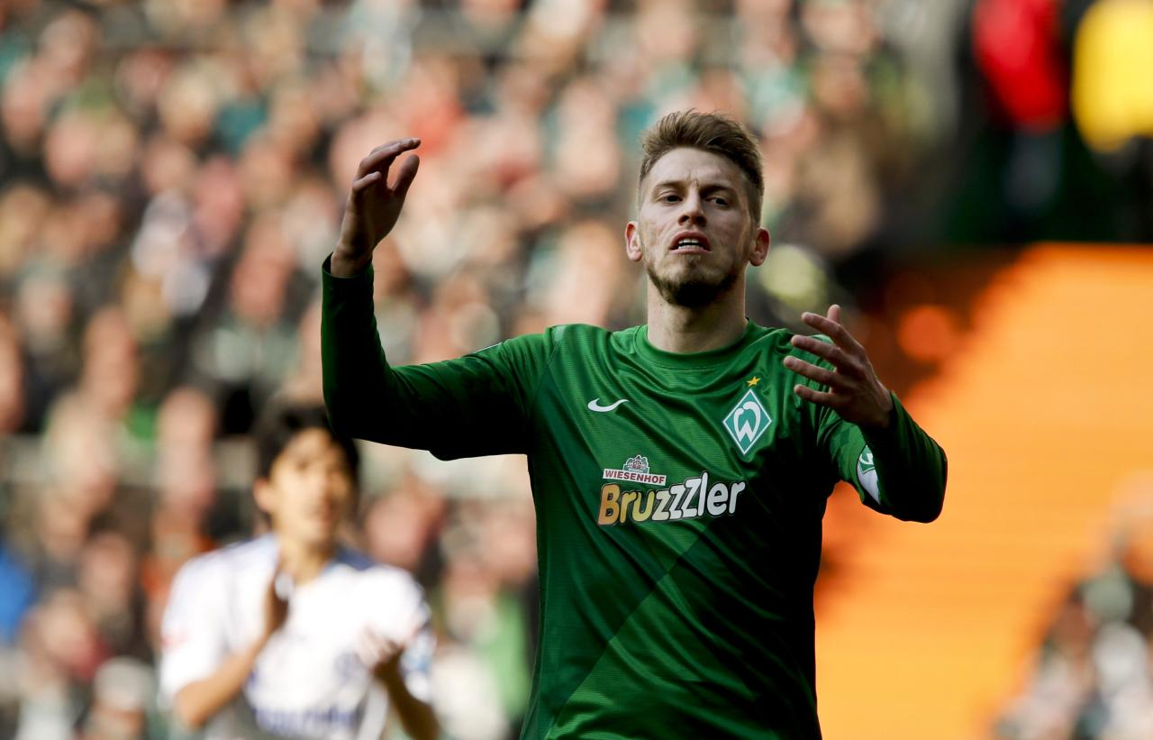 Bremen's midfielder Aaron Hunt reacts during the German first division Bundesliga football match SV Werder Bremen vs FC Schalke 04 in Bremen, northern Germany, on April 6, 2013.     AFP PHOTO / PHILIPP GUELLAND  RESTRICTIONS / EMBARGO - DFL RULES TO LIMIT THE ONLINE USAGE DURING MATCH TIME TO 15 PICTURES PER MATCH. IMAGE SEQUENCES TO SIMULATE VIDEO IS NOT ALLOWED AT ANY TIME.  FOR FURTHER QUERIES PLEASE  CONTACT THE  DFL DIRECTLY AT + 49 69 650050PHILIPP GUELLAND/AFP/Getty Images