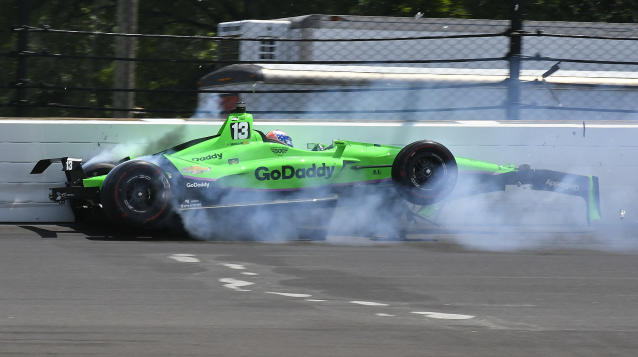 "<a class=""link rapid-noclick-resp"" href=""/nascar/nationwide/drivers/1311"" data-ylk=""slk:Danica Patrick"">Danica Patrick</a> hits the wall in the second turn during the running of the Indianapolis 500 auto race at Indianapolis Motor Speedway, in Indianapolis Sunday, May 27, 2018. (AP)"