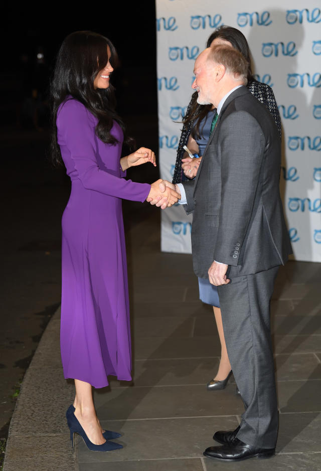 The Duchess of Sussex greets Ian McCullough at the One Young World Summit Opening Ceremony at Royal Albert Hall. [Photo: Getty]