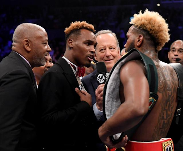 Jermall Charlo teases Jarrett Hurd (R) after his third round KO of Jason Welborn during the WBA-IBF-IBO junior middleweight championship on Dec. 1, 2018 in Los Angeles. (Harry How/Getty Images)