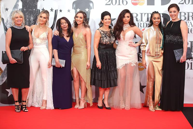 Here they are with their mothers on the red carpet at the Brit Awards. Adorable.