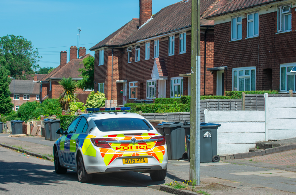 Police visit Louise Lawford's house in Birmingham (SWNS)